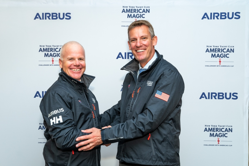 Airbus Commercial Aircraft EVP Engineering Jean-Brice Dumont (R) and American Magic's Executive Director and Skipper Terry Hutchinson smile after announcing their Innovation partnership in a ceremony at the New York Yacht Club